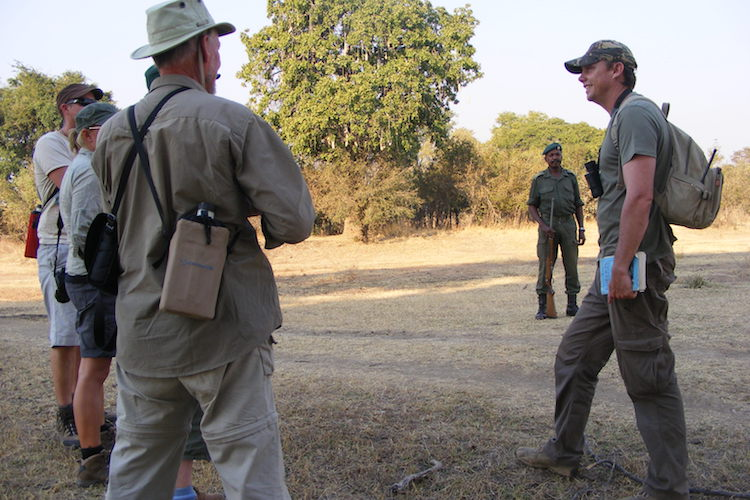 Safety briefing before a walking safari at Nkonzi